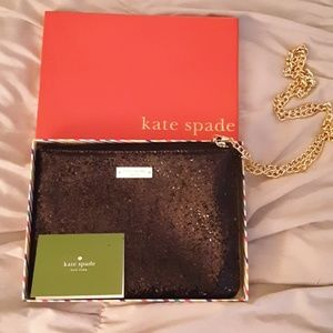 Black shiny Kate Spate wristlet with chain
